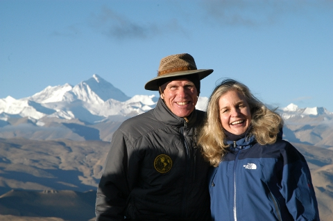 Peter Hillary and his wife, Yvonne Oomen, in Tibet. The north face of Everest is above Peter's right shoulder.