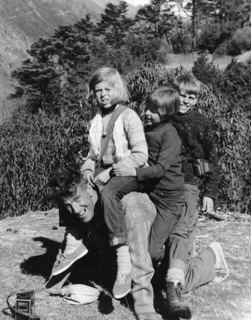 Peter Hillary and his sisters play on their father's back