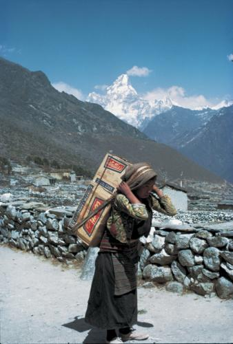Carrying building supplies in Nepal.  All supplies need to be carried in as there is no vehicle access in the mountainous regions of Nepal